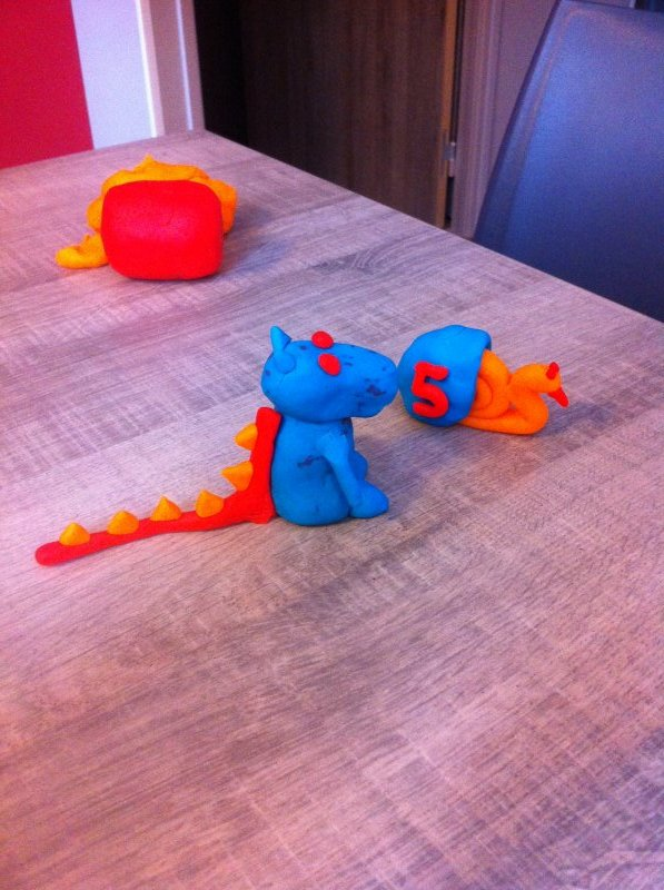Playing with PlayDoh, we made a dragon and Turbo.